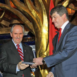 "Albanian President Bamir Topi gives his country's Presidential ""Medal of Gratitude"" to Elez Biberaj, the Director of Voice of America's Eurasia Division."