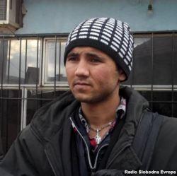 Afghani migrant at the Serbia-Macedonia border