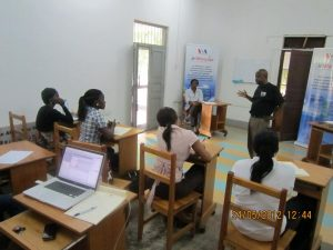 "Four citizen journalists learn effective broadcasting techniques in a training session with Mwamoyo Hamza. In a previous interview Mwamoyo said, ""We don't only report an event: instead, we always think about why this event happened. This has more meaning than just the event itself."""