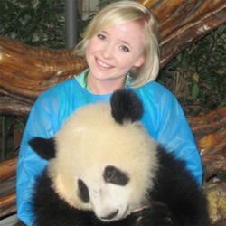 Jessica Beinecke, the host of VOA's popular English learning blog OMG! Meiyu, posing with a panda in Chana.