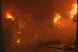 A still from Alhurra TV footage shows furniture burning at the site of the attack on the U.S. Consulate in Benghazi, Libya.