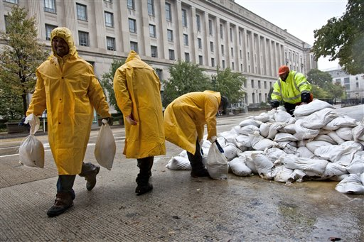 Workers haul sandbags to shore up vulnerable spots near federal buildings in Washington, DC