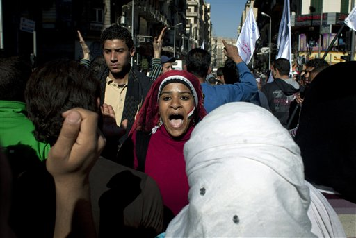 A demonstrator makes here position on the constitution known in Cairo. (AP Images)