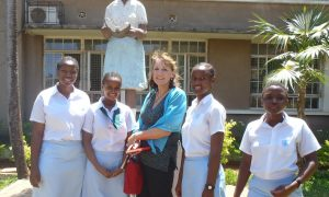 Ms. Mower visiting the girls at her alma mater in Dar Es Salaam, Tanzania, formerly the HH Aga Khan Girls Secondary School during her time, now the Zanaiki Girls School.