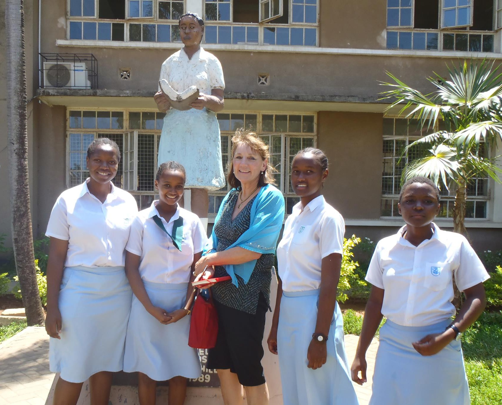 Ms. Mower visiting the girls at her alma mater in Dar Es Salaam, Tanzania, formerly the HH Aga Khan Girls Secondary School during her time, now the Zanaiki Girls School