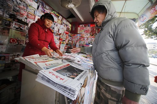 The latest edition of the Southern Weekly newspaper, bottom, is sold at a newspaper stand Thursday Jan. 10, 2013 in Shanghai, China. The Southern Weekly newspaper whose staff rebelled to protest heavy-handed censorship by China's government officials published as normal Thursday after a compromise that called for relaxing some intrusive controls but left lingering ill-will among some reporters and editors. (AP Photo)