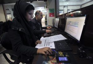 Iranians surf the web in an internet cafe at a shopping center, in central Tehran, Iran, Sunday, Jan. 6, 2013. (AP Photo/Vahid Salemi)