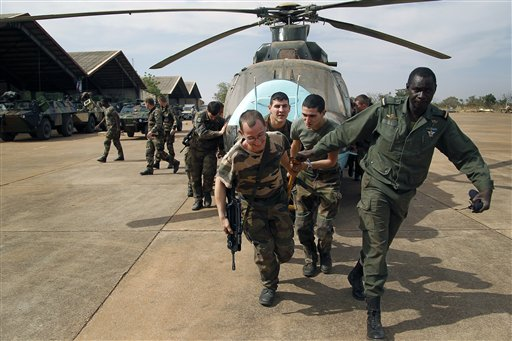 French troops, like these assisting Malian soldiers at Bamako's airport, have recently joined in the government's fight against Islamist extremist rebels. (AP Photo/Jerome Delay)
