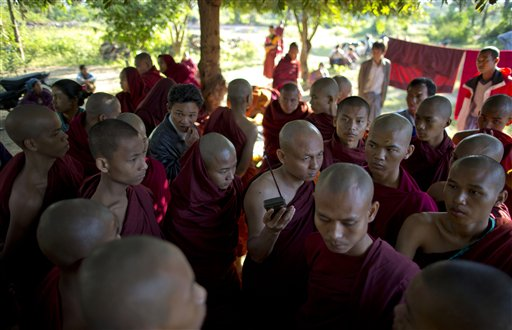 Buddhist monks, some of who escape from the security forces crack down, listen to radio news cast from a monastery in Monywa, northwestern Myanmar, Thursday, Nov. 29, 2012 (AP)