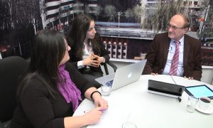 "(from left to right) RFE/RL's Siranuysh Gevorgyan, Ruzanna Stepanyan and Hrair Tamrazian during a live Google+ Hangout broadcast from Yerevan on December 13, 2013. Not pictured are Richard Giragosian, founding director of the Regional Studies Center (RSC), and Artur Papyan, a journalist with RFE/RL's Armenian Service and author of the blog ""The Armenian Observer,"" who also participated in the Google+ Hangout. (Credit: azatutyun.am/ RFE/RL)"