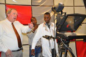 Professor Sam Swan helps train staff of MBC