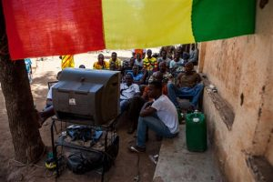 Malians gather around an outdoor television set to watch the semifinal round of the Africa Cup of Nations, in Bamako, Mali, Wednesday, Feb. 6, 2013. (AP Photo/Thomas Martinez)