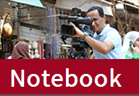 The word Notebook over a photo of a man using a video camera