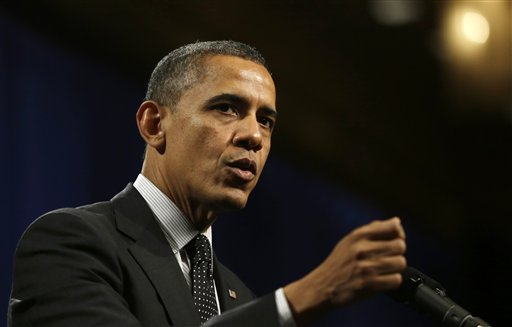 President Barack Obama gestures as he speaks at the House Democratic Issues Conference in Lansdowne, Va., Thursday, Feb. 7, 2013. (AP Photo/Charles Dharapak)