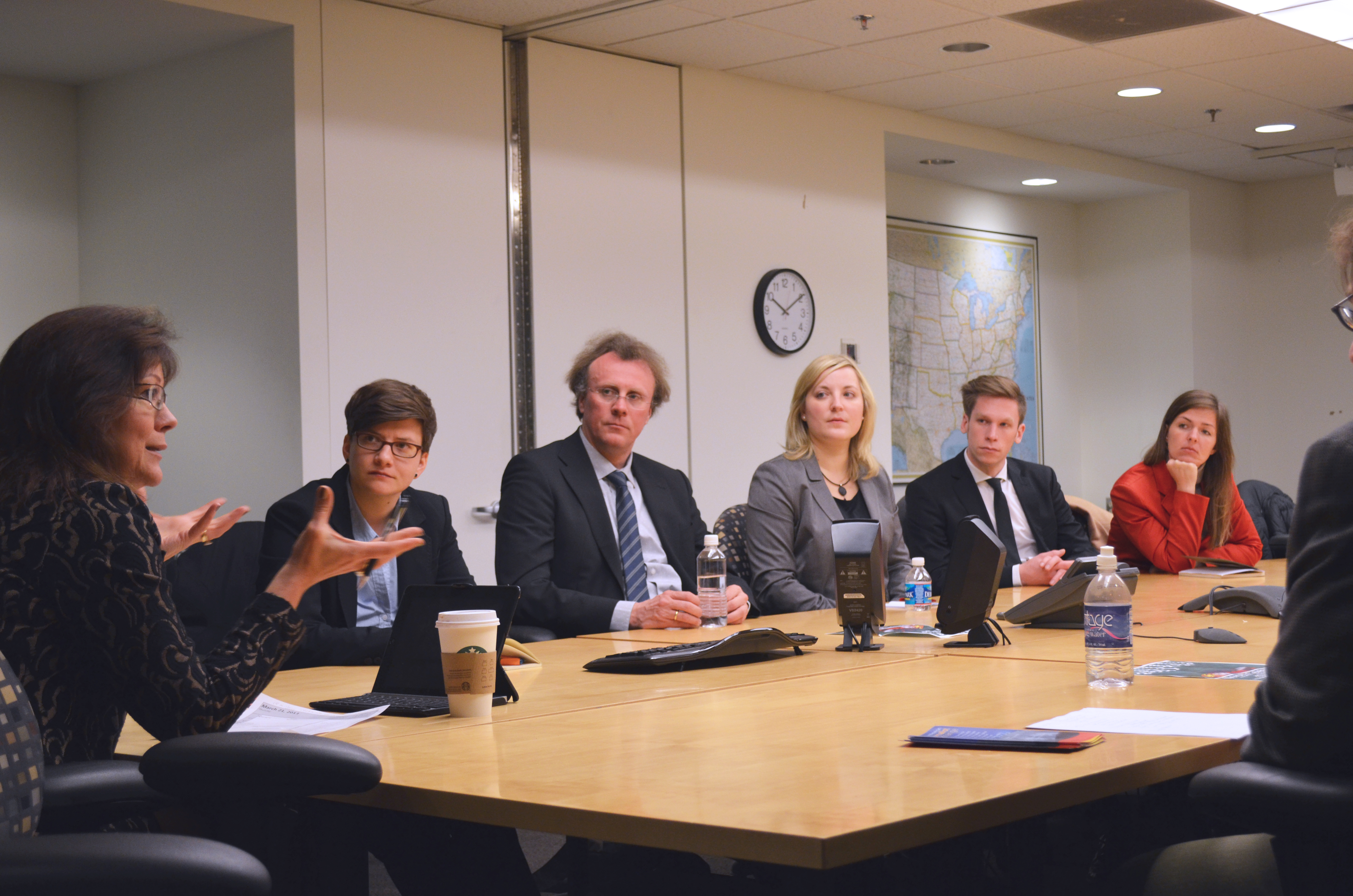 VOA Associate Director of Language Programming Rebecca MacMenamin meets with visiting German journalists.
