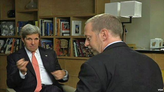 John Kerry speaks with VOA reporter