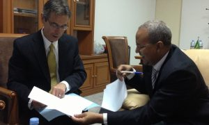 BBG Director of Strategy and Development Bruce Sherman signs agreement with the head of Telediffusion de Mauritanie (TDM), Dieh Sidaty.