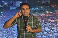 Alhurra reporter broadcasting from streets with demonstrations