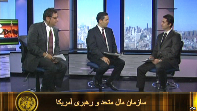 Three men on TV set talking