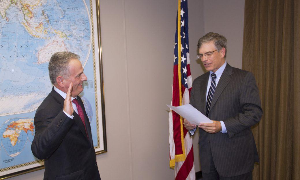 IBB Deputy Director Jeff Trimble swears in Kenneth Weinstein as a member of the BBG.
