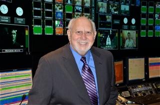 Richard Lobo in a control room