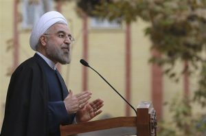 Iran's President Hassan Rouhani speaks during a news briefing after Iran and world powers agree in Geneva to a deal over Iran's nuclear program, at the Presidency compound in Tehran, Iran, Sunday, Nov. 24, 2013.