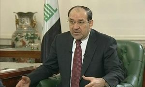 Maliki gestures with his hands as he speaks with reporter (off camera)