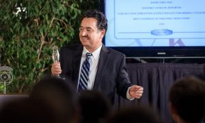 Radio Free Asia Uyghur Service reporter Shohret Hoshur accepts silver medal at the New York Festivals radio awards ceremony.