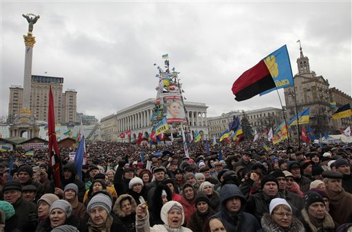 Pro-European Union activists attend a rally in Independence Square in Kyiv, Ukraine, Sunday, Jan. 12, 2014. Tens of thousands of activists rallied in the center of the Ukrainian capital on Sunday, while the organizers of the weeks-long anti-government protests looked for a future strategy amid dwindling numbers and a continuing government crackdown on the protesters. (AP Photo/Sergei Chuzavkov)