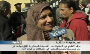 woman on the street speaks with Alhurra reporter