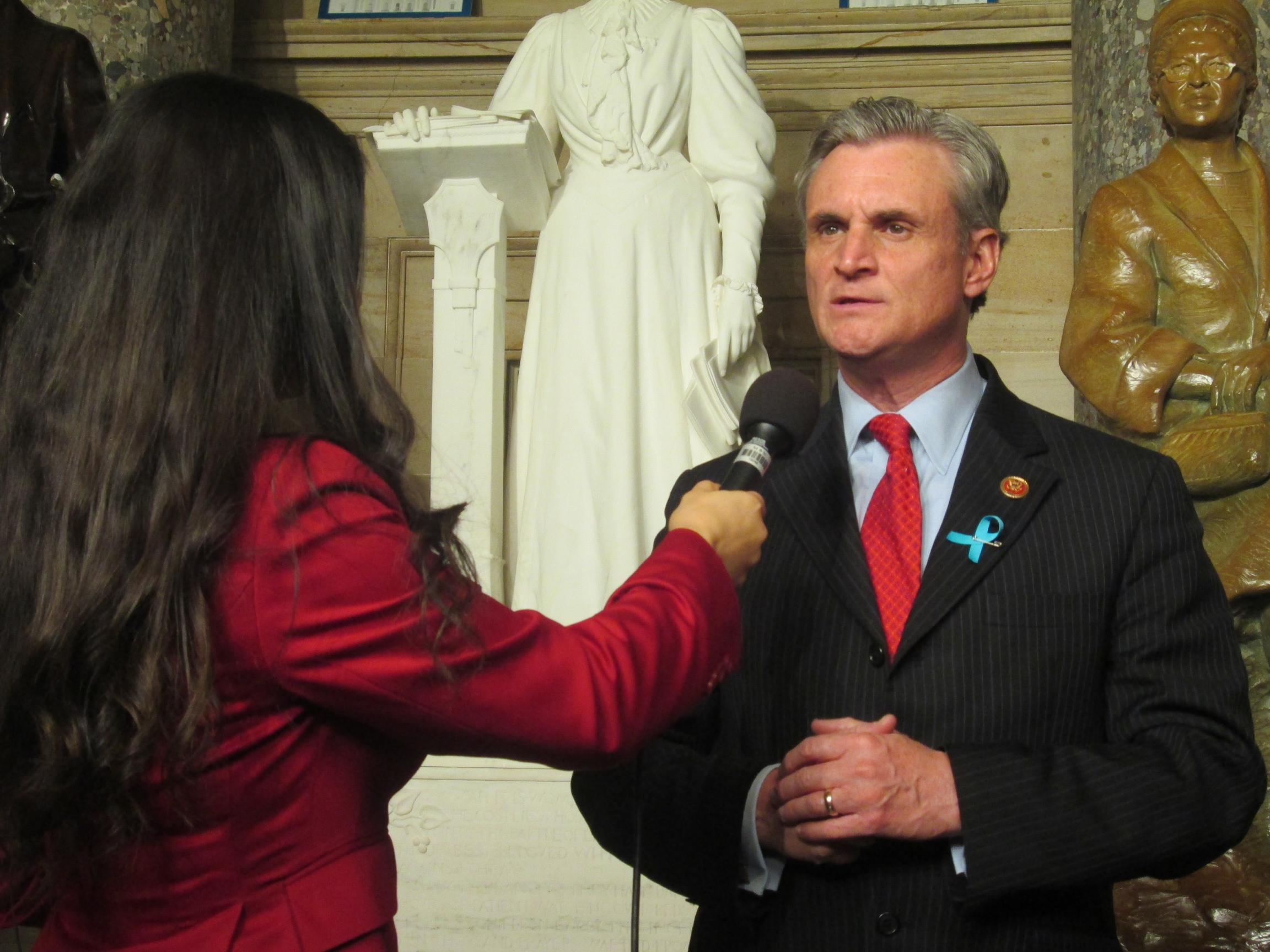 reporter interviews man