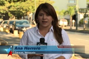 Reporter speaking while on the street in Caracas