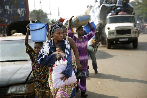 At PK12 thousands of Muslim residents from Bangui and Mbaiki flee the Central African Republic Bangui in a mass exodus using cars, pickups, trucks, lorries and motorcycles, escorted by Chadian troops on Friday Feb. 7, 2014. Tit-for-tat violence killed more than 1,000 people in Bangui alone in a matter of days in December. An untold number have died in the weeks that followed, with most of the attacks in Bangui targeting Muslims.