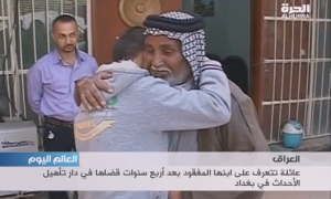 Father and son hug as they are reunited after 4 years