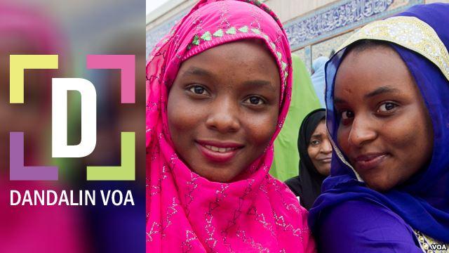 Dandolin VOA logo with two women in bright head scarves