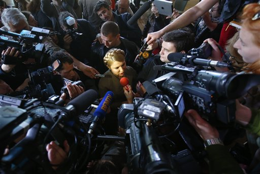 "Surrounded by reporters, former Ukrainian prime minister and presidential hopeful Yulia Tymoshenko speaks to journalists after her press conference in Donetsk, Ukraine, Friday, April 18, 2014. Tymoshenko arrived Friday in Donetsk in a bid to defuse the tensions and hear ""the demands of Ukrainians who live in Donetsk."" (AP Photo/Sergei Grits)"