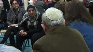 Members of the Jewish and Muslim community participate in a discussion.