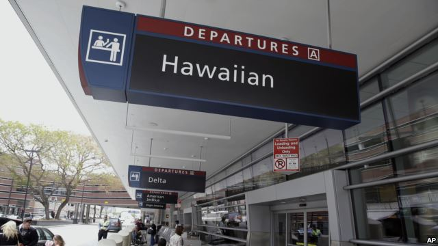 People make their way into Terminal A at Mineta San Jose International Airport near the Hawaiian Airlines gates, April 21, 2014, in San Jose, Calif. Photo Credit: AP