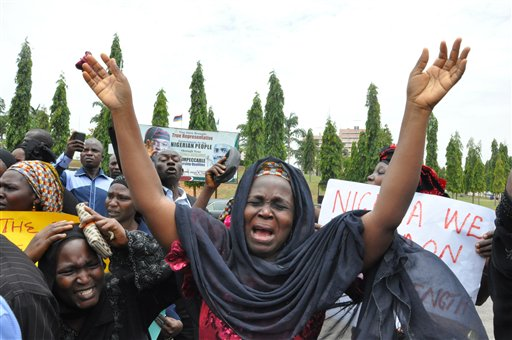 An unidentified mother cries out during a demonstration with others who have daughters among the kidnapped school girls of government secondary school Chibok, Tuesday April 29, 2014, in Abuja, Nigeria.