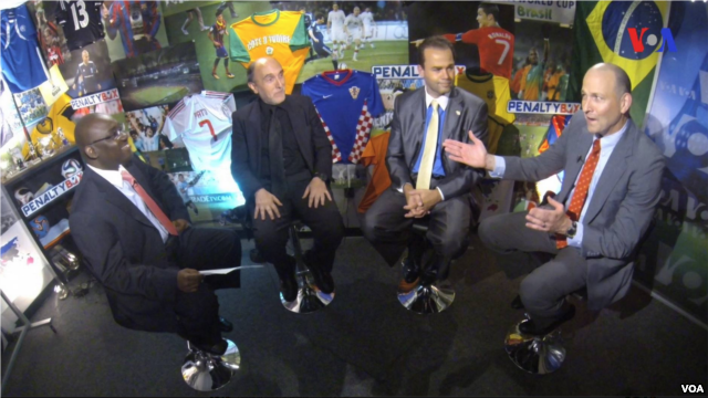 Four men sitting in stools talking about World Cup