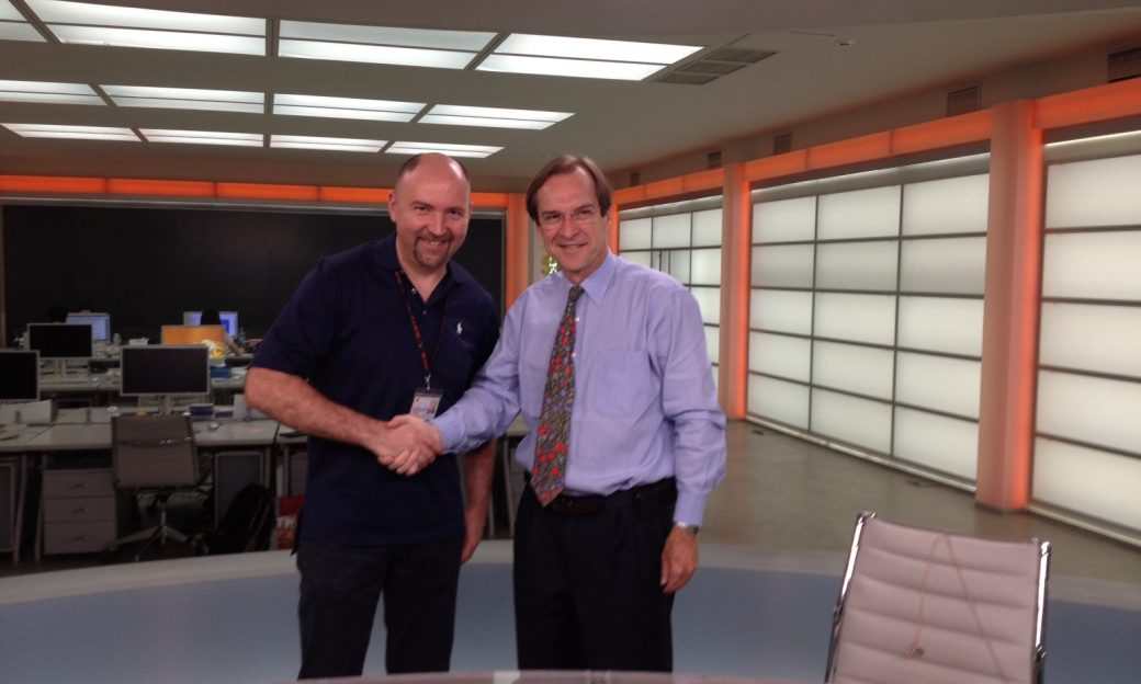 VOA Director David Ensor shakes hands with ICTV Director and President Oleksandr Bohutsky at the ICTV office in Kyiv.