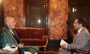 VOA's Ahmad Fawad Lami (right) interviews President Karzai on Monday, July 14 at the Presidential Palace in Kabul.