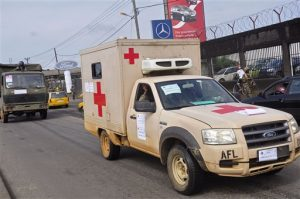 Liberian soldiers in a medical truck, with papers on it reading 'EBOLA MOST GO' drive past as they patrol streets to prevent panic, as fears of the deadly Ebola virus spread in the city of Monrovia, Liberia, Friday, Aug 1, 2014. (AP Photo/Abbas Dulleh)