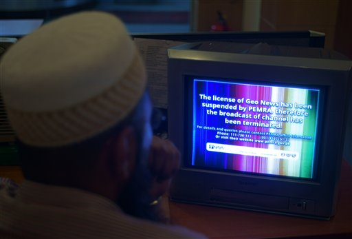 A Pakistani viewer looks at a television screen