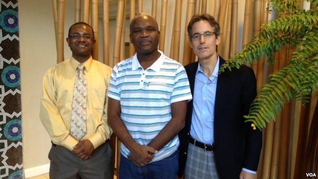 Three men smiling at camera