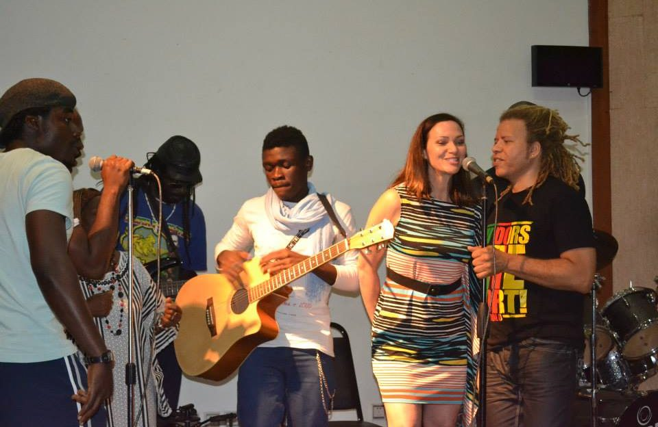 Heather Maxwell joins musicians onstage in Cameroon