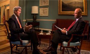 Secy State John Kerry sits across from VOA reporter