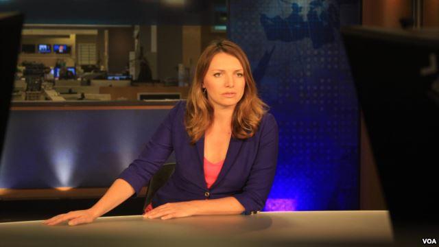 Female anchor at desk