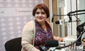 Femal reporter in radio studio