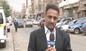 Reporter with microphone on Yemeni street